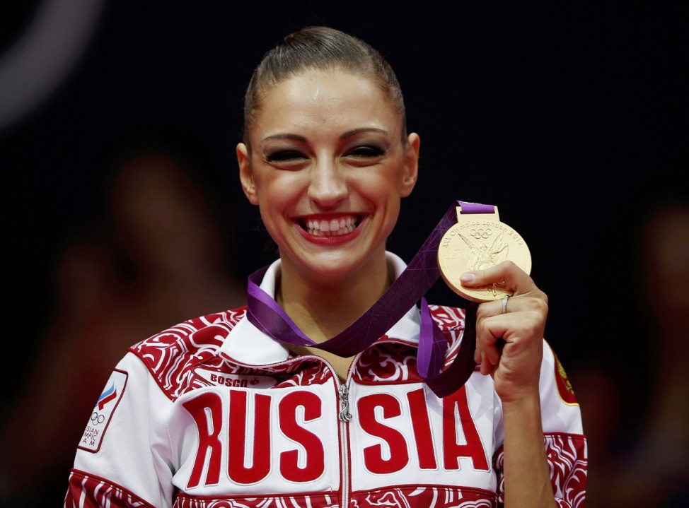 Russia's Evgeniya Kanaeva celebrates with her gold medal in the victory ceremony after the individual all-around rhythmic gymnastics final at the London 2012 Olympic Games