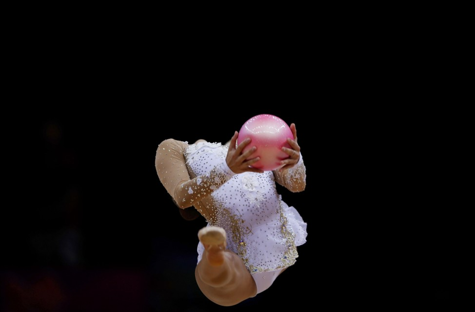 Russia's Evgeniya Kanaeva competes using the ball in the individual all-around rhythmic gymnastics final at the London 2012 Olympic Games