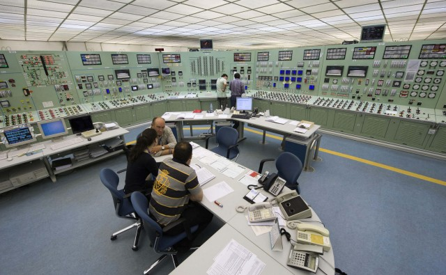 Employees work in the control room of the Garona nuclear plant, near the city of Burgos