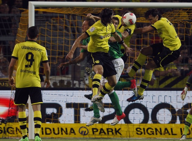 Borussia Dortmund's Hummels, Subotic and Werder Bremen's players jump for a ball during the German first division Bundesliga soccer match in Dortmund
