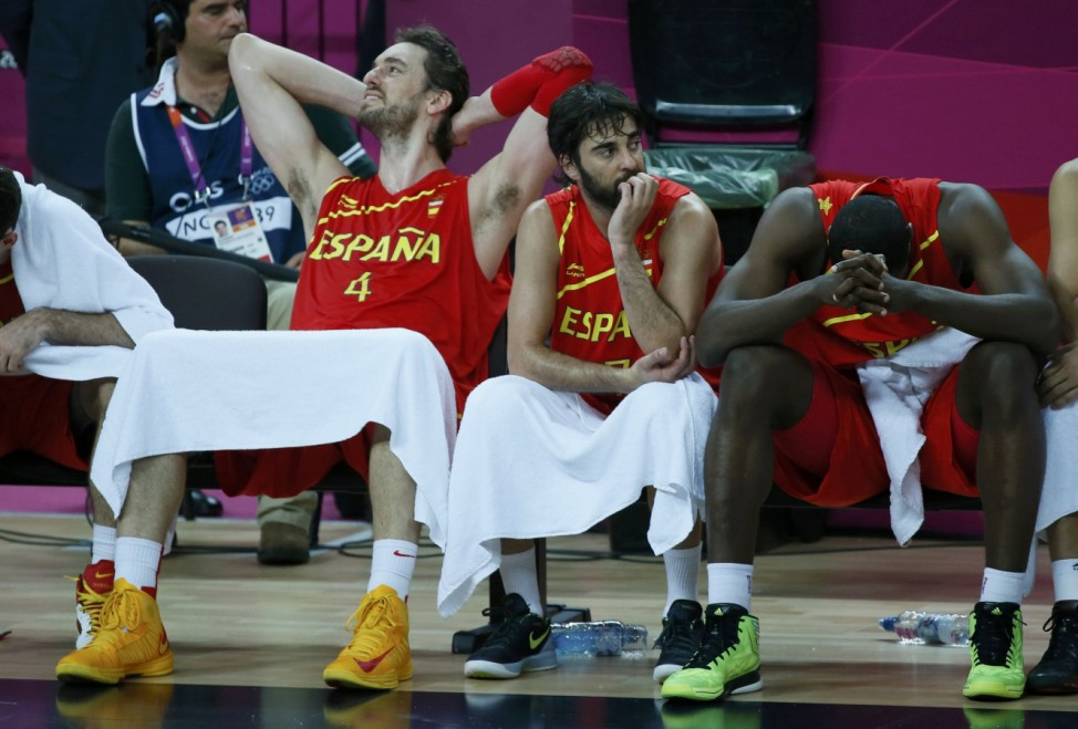Spain's players sit on the bench during game against the U.S. at their men's gold medal  basketball match at the North Greenwich Arena in London during the London 2012 Olympic Games
