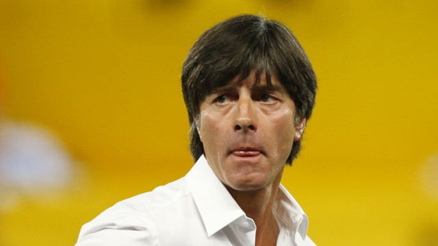 Germany's head coach Loew watches before their 2014 World Cup qualifying soccer match against Austria in Vienna