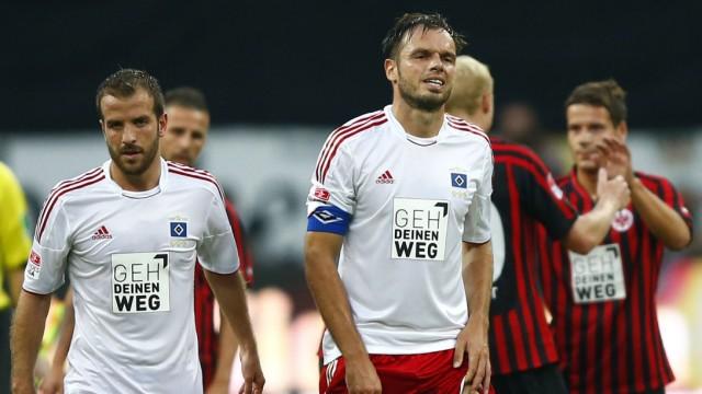 der Vaart, Dutch midfielder from HSV Hamburg, and team captain Westermann walk off pitch after their German first division Bundesliga soccer match in Frankfurt
