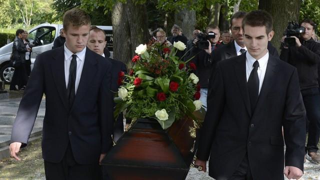 The coffin of 12 German-speaking civilians displayed during a bur
