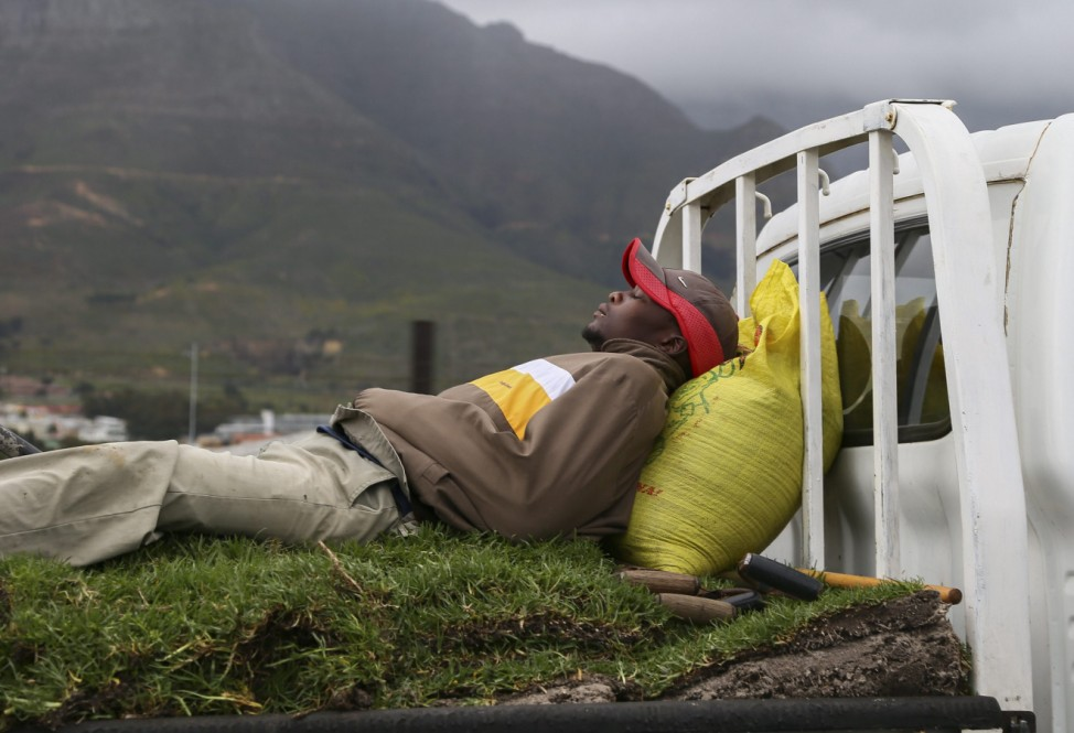 A man sleeps on moving lawn in Cape Town, South Africa