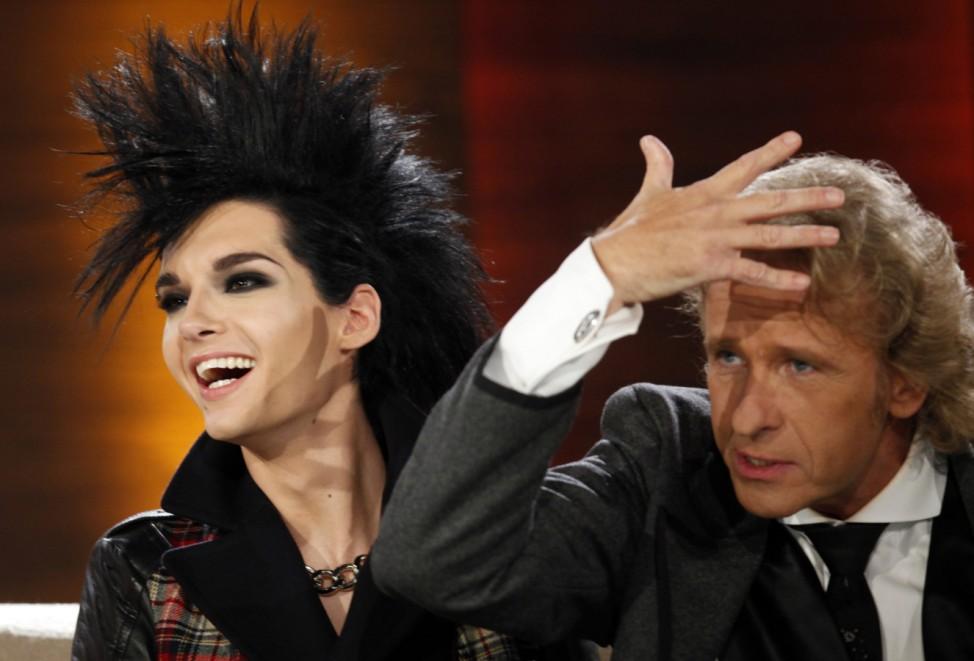 German TV show host Gottschalk (L) talks to Kaulitz of the band Tokio Hotel during the German TV game show 'Wetten dass...?' (Bet it...?) in Freiburg