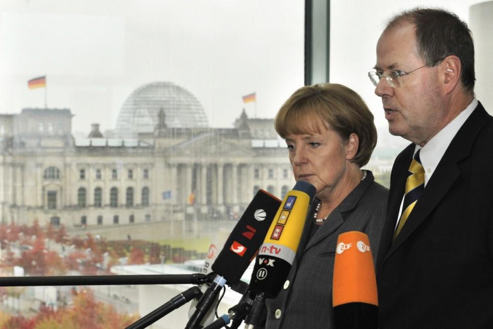 Hypo Real Estate - Merkel und Steinbrück