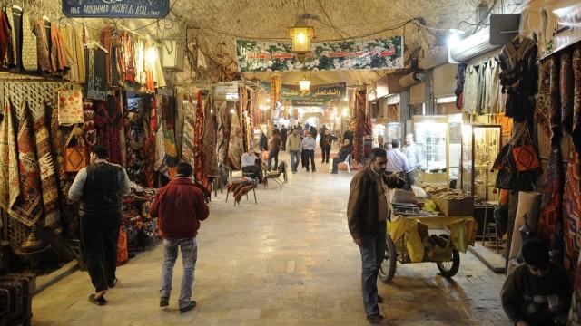 File photo of people walking through Al-Madina Souq market in Aleppo