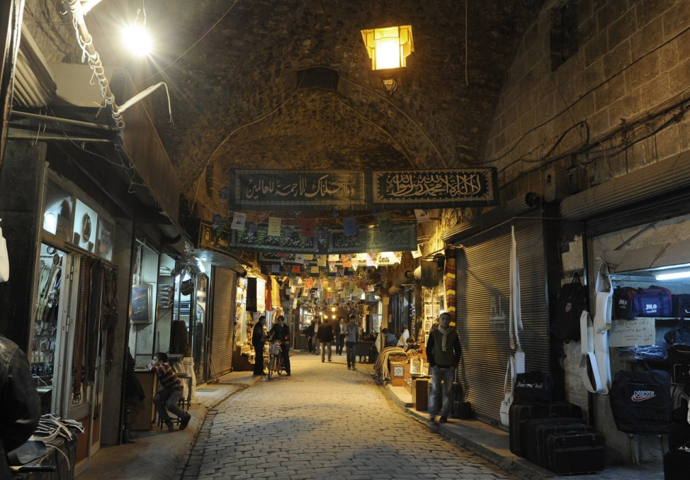 File picture of people walking through Al-Madina Souq market in Aleppo