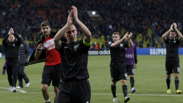 Celtic's Brown and teammates applaud supporters after their team's Champion's League Group G soccer match against Spartak Moscow in Moscow's Luzhniki Stadium