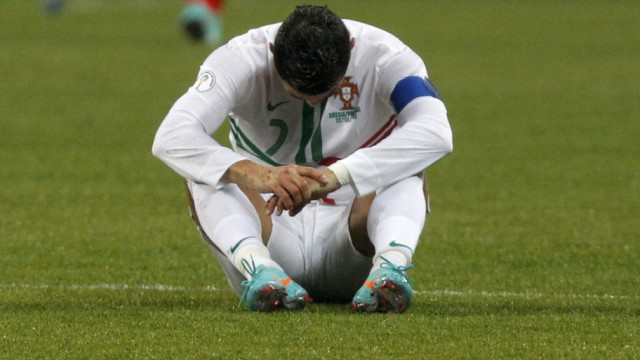 Portugal's Cristiano Ronaldo sits on the pitch during the 2014 World Cup Group F qualifying soccer match against Russia at the Luzhniki stadium in Moscow