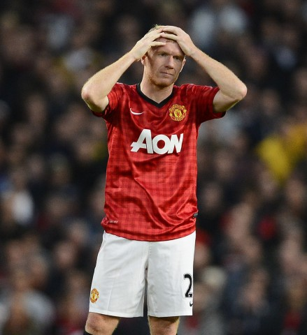 Manchester United's Scholes holds his head during their English Premier League soccer match against Tottenham Hotspur at Old Trafford in Manchester