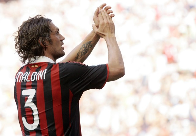 AC Milan's Maldini waves to the supporters at the end of the Italian Serie A soccer match against AS Roma in Milan
