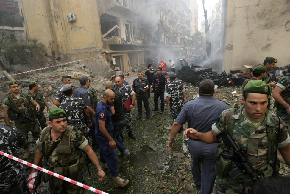 Lebanese army soldiers and policemen secure the site of an explosion in Ashafriyeh