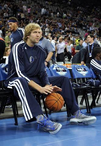 Dallas Mavericks' Dirk Nowitzki watches their friendly NBA Europe Live basketball match against Barcelona in Barcelona