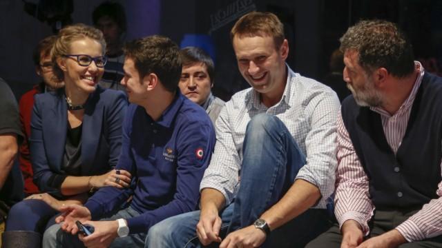 Russische Opposition: Die Führer der russischen Opposition (von rechts nach links): Journalist Sergeij Parkhomenko, Blogger Alexej Nawalny, Politiker Ilja Jashin und die Sozialistin Xenia Sobchak.