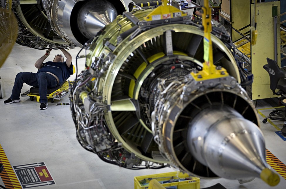 A worker builds an engine for the Boeing 737-900 at their assembly operations in Renton