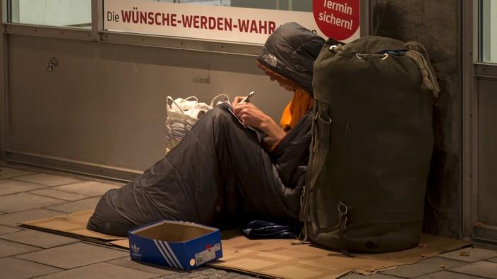 Obdachlos vor der Bank