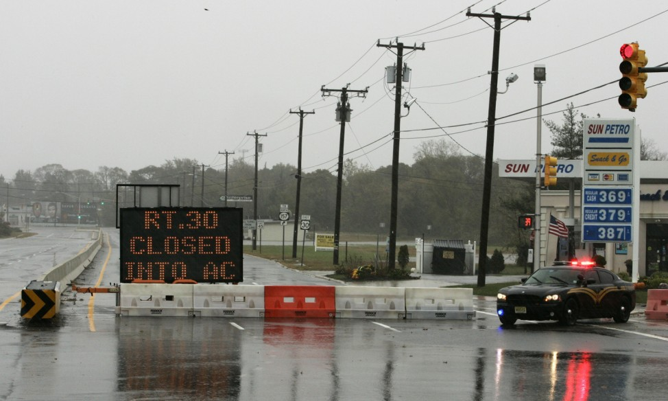 A police car and traffic sign block U.S. Route 30 East at Route 9 in Absecon, to prevent traffic from going into Atlantic City, New Jersey, during the approach of Hurricane Sandy