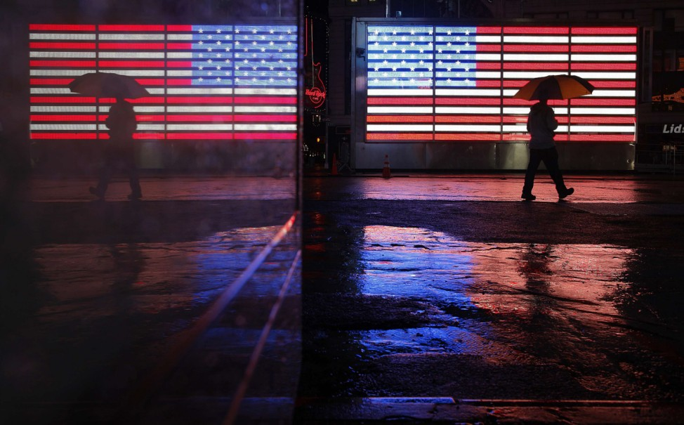 A man walks through a mostly deserted Times Square ahead of Hurricane Sandy in New York