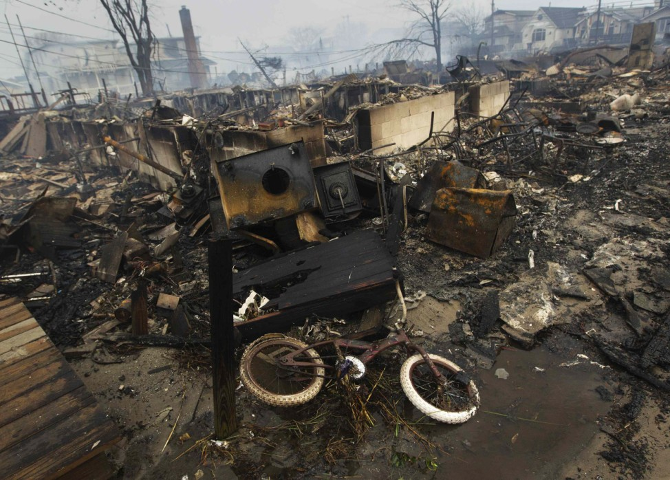 A view shows homes devastated by fire and the effects of Hurricane Sandy at the Breezy Point section of the Queens borough of New York