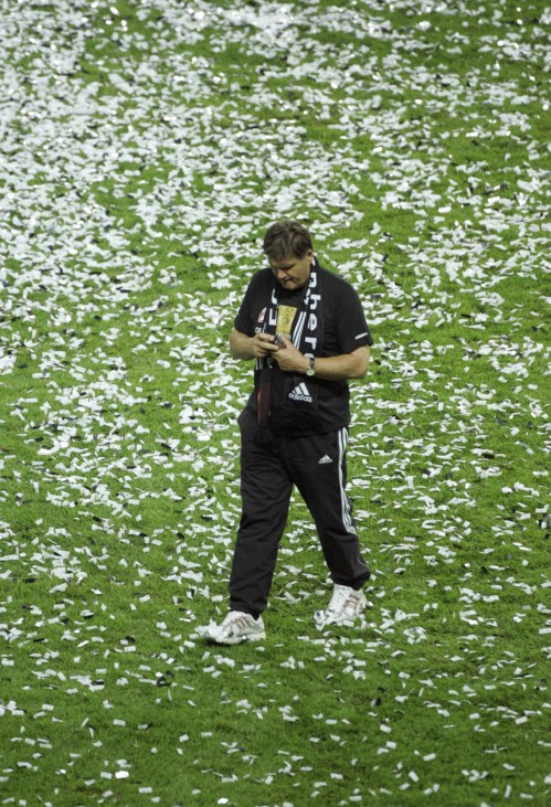 Nuremberg's coach Meyer walks on the pitch after defeating VfB Stuttgart to win the German soccer cup DFB-Pokal final match in Berlin