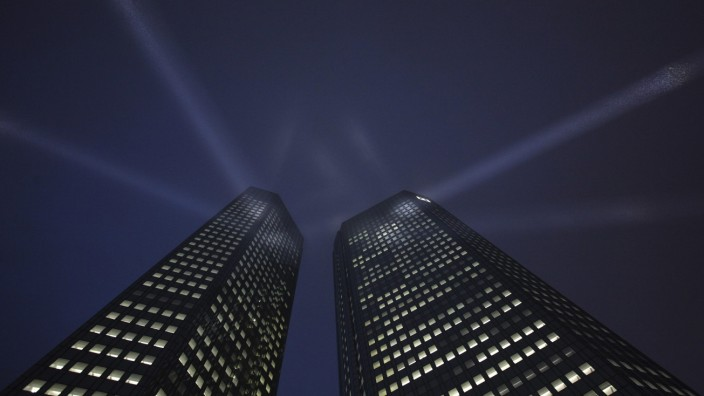 File photo of the headquarters Deutsche Bank being spotlighted during a ceremony in Frankfurt