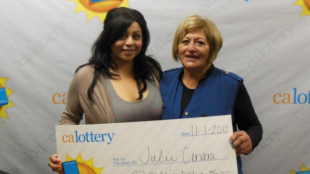 Publicity handout photo showing Borunda posing with her mother Cervera at a Calfornia Lottery news conference in San Bernardino