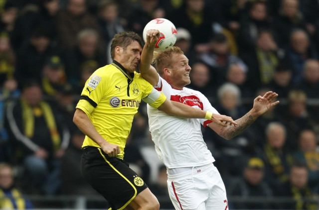 Borussia Dortmund's Kehl and Stuttgart's Holzhauser head a ball during the German first division Bundesliga soccer match in Dortmund