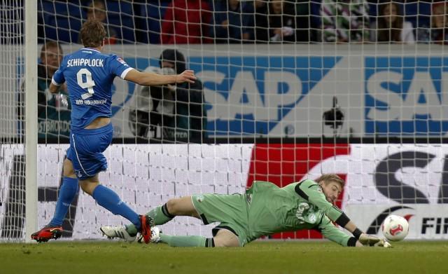 Hoffenheim's Schipplock scores a goal past Schalke 04's goalkeeper Lars Unnerstall during their German first division Bundesliga soccer match in Sinsheim