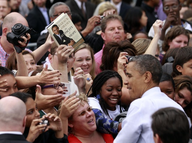 A copy of U.S. President Barack Obama's book 'The Audacity of Hope' is held by a supporter looking for an autograph during a campaign rally at George Mason University in Fairfax