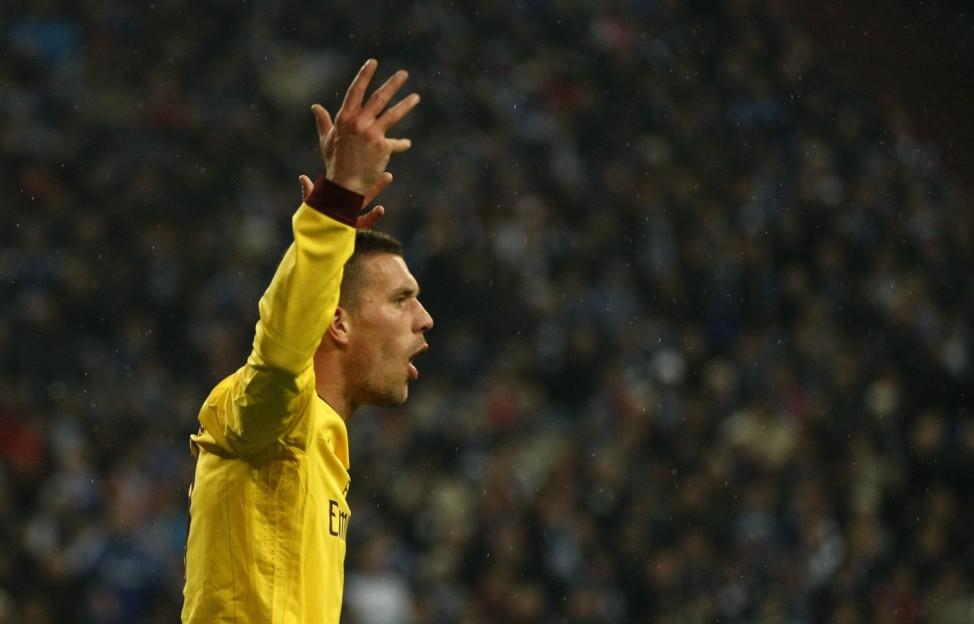 Arsenal's Podolski reacts during their Champions League Group B soccer match against Schalke 04 in Gelsenkirchen