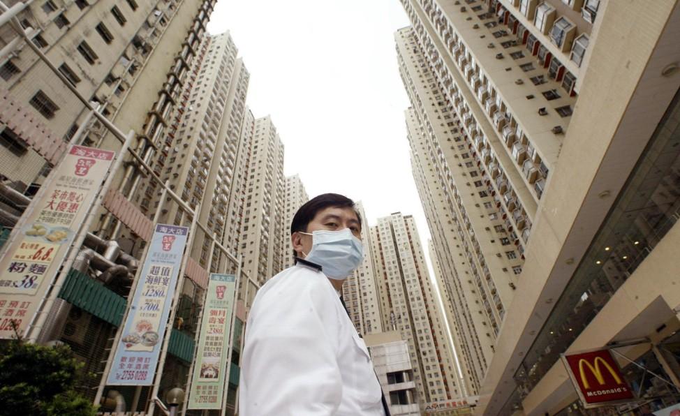 SARS-Neuinfizierte: Hongkonger Wohnanlge Amoy Garden unter Quarantäne gestellt, 2003