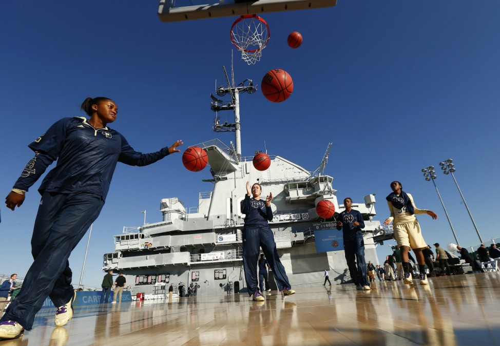 Notre Dame Fighting Irish guard Cable warms up with her team before playing the Ohio State Buckeyes during the Carrier Classic college basketball game being played on board the U.S.S. Yorktown in Charleston
