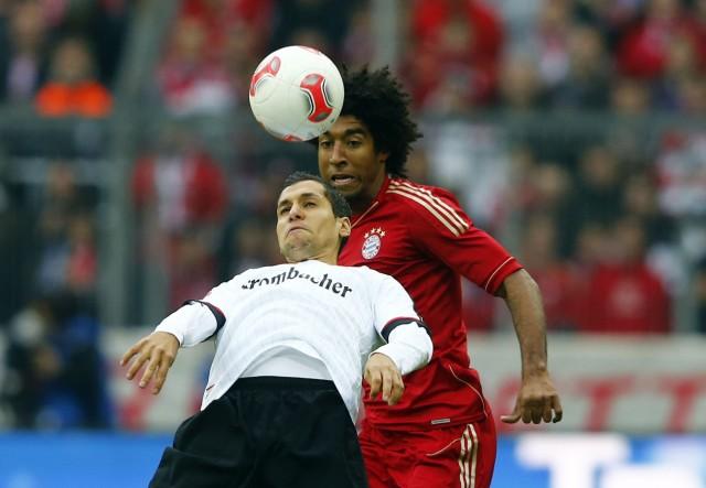 Munich's Dante challenges Eintracht Frankfurt's Karim Matmour during their German Bundesliga first division soccer match in Munich