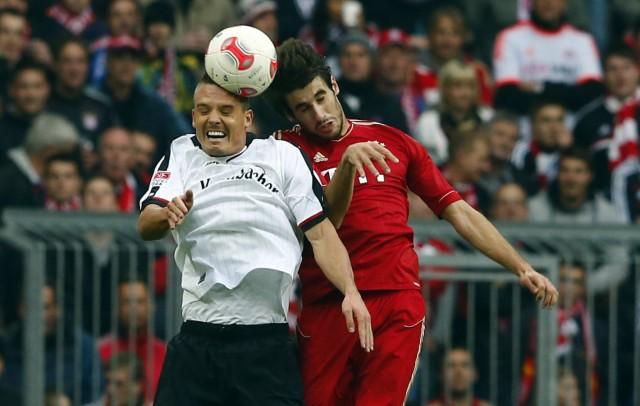 Munich's Martinez challenges Eintracht Frankfurt's Meier during their German Bundesliga first division soccer match in Munich
