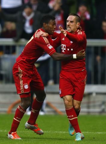 Ribery of Bayern Munich celebrates with team mate Alaba after scoring  against Eintracht Frankfurt during Bundesliga soccer match in Munich
