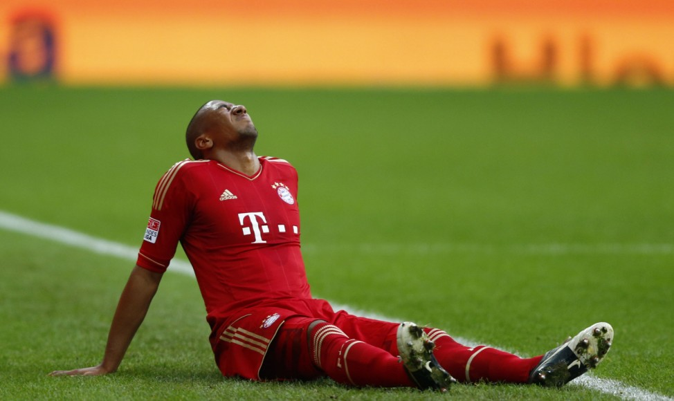 Jerome Boateng of Bayern Munich grimaces in pain during their German first division Bundesliga soccer match against Eintracht Frankfurt in Munich