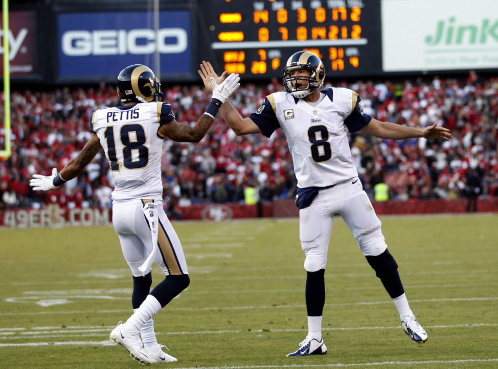 St. Louis Rams wide receiver Austin Pettis is congratulated by quarterback Sam Bradford after scoring a touchdown on a Bradford pass against the San Francisco 49ers during their NFL football game in San Francisco