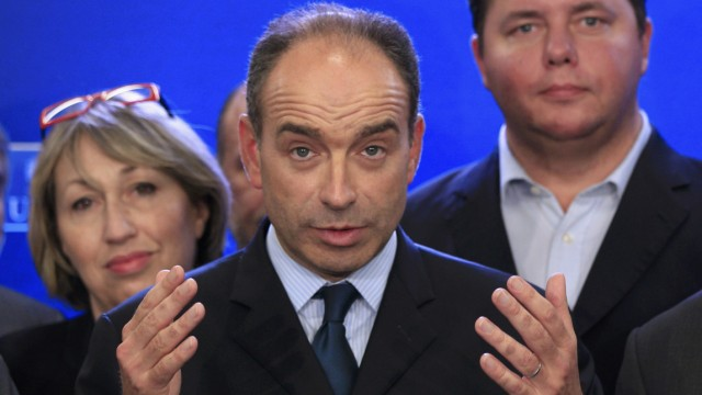 French politician Cope attends a news conference after he won the election to head the UMP political party at their headquarters in Paris