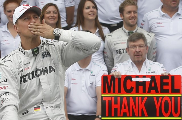 Mercedes Formula One driver Schumacher gestures during a photo call before the Brazilian F1 Grand Prix at Interlagos circuit in Sao Paulo