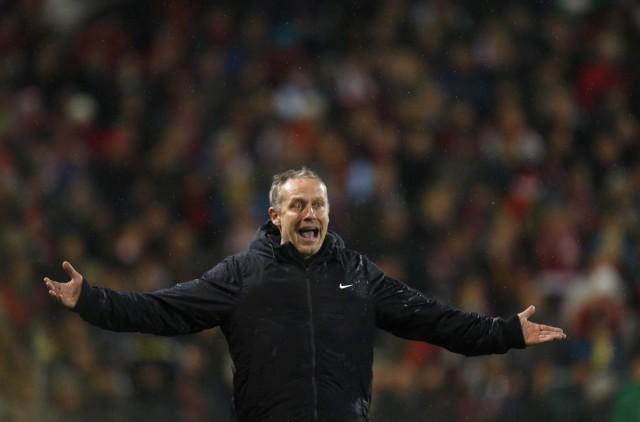 SC Freiburg's coach Streich reacts during the German first division Bundesliga soccer match against Bayern Munich in Freiburg