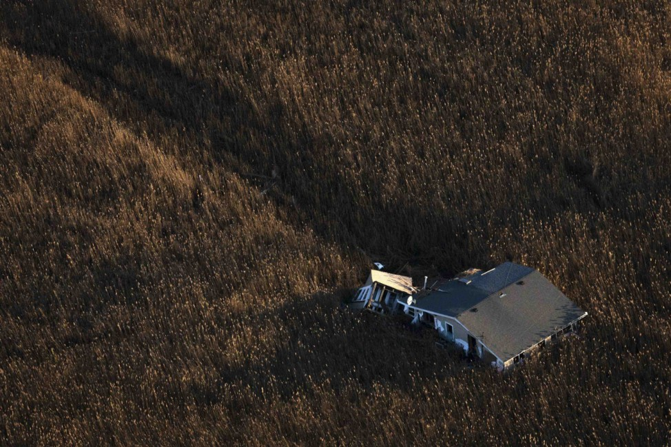 An aerial view shows a house pushed into marshland almost a month after the Oakwood neighborhood in the Staten Island borough of New York was left devastated by Hurricane Sandy
