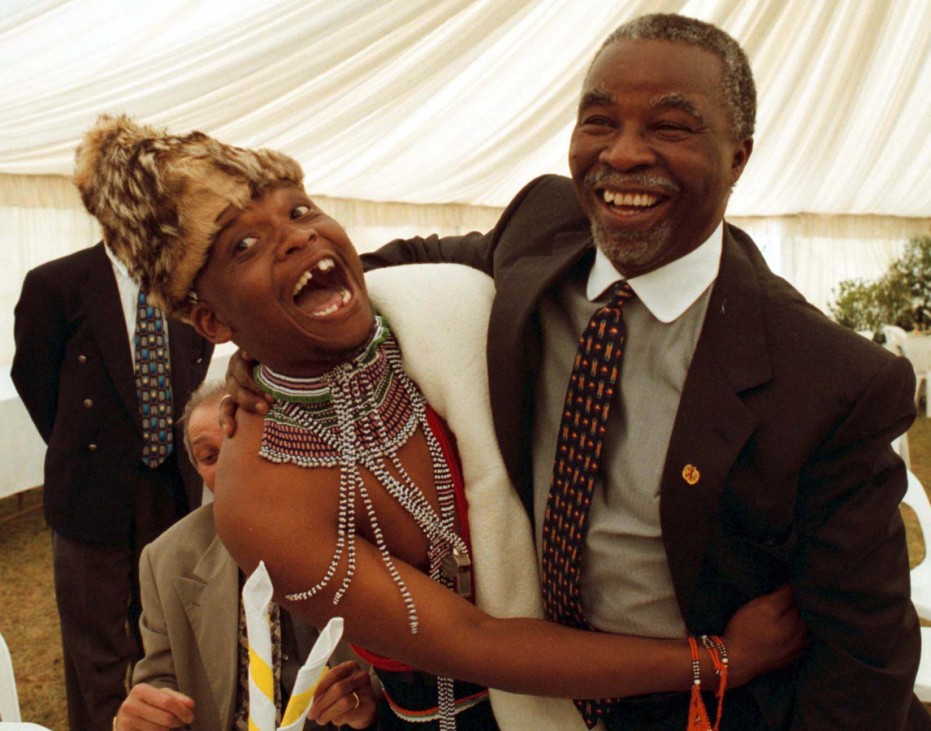DEPUTY PRESIDENT MBEKI IS GREETED BY A PRAISE SINGER