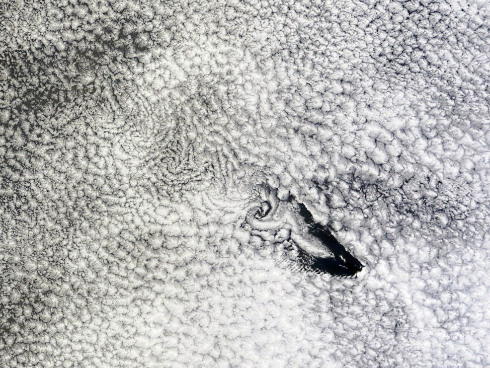 NASA satellite image of St. Helena Island and the band of wind-blown cloud vortices trailing towards the island's leeward side over the South Atlantic Ocean