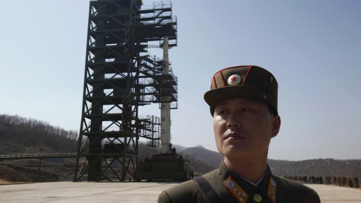 File photo of a soldier in front of a rocket sitting on a launch pad at the West Sea Satellite Launch Site, northwest of Pyongyang