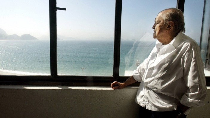 File photo of Brazilian architect Oscar Niemeyer looking at the Copacabana beach in Rio de Janeiro
