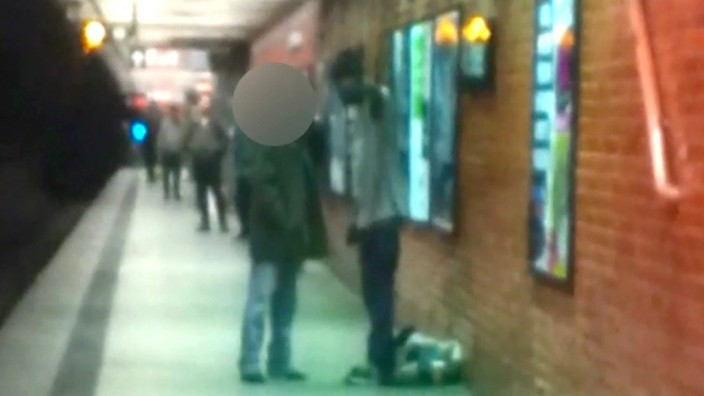 Two men are seen talking on a New York City subway platform in this framegrab from a video released by the New York City Police Department