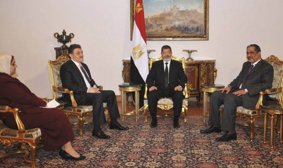 Egypt's President Mursi meets with Mady, head of the moderate Wasat Party, and Badawi, the head of the Wafd party, at the presidential palace in Cairo