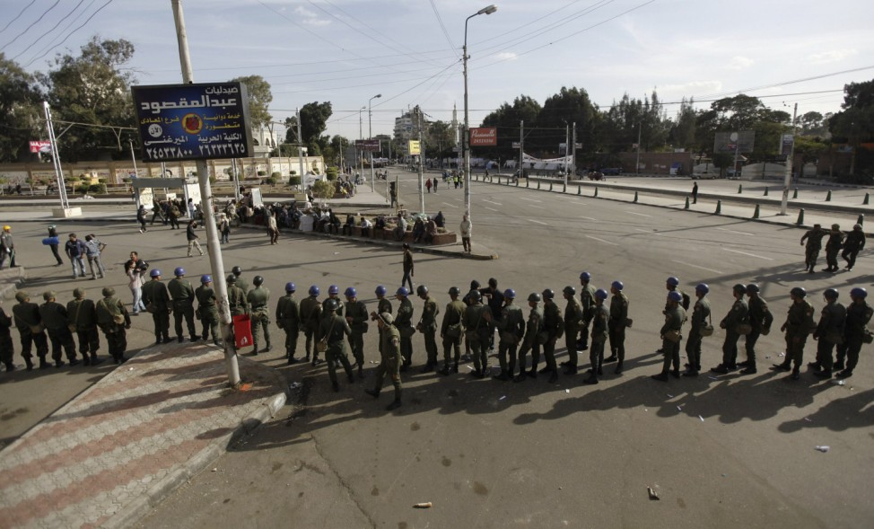 Members of the Republican Guard block a road in front of the presidential palace in Cairo